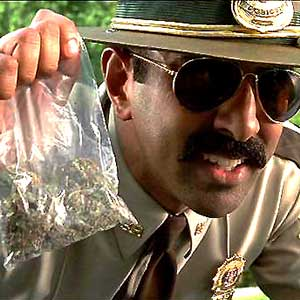 Cop-With-bag-of-Weed